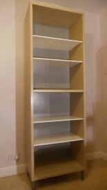 Shelf unit with adjustable shelves and removable legs.
