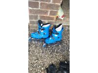 Inline skates. Adjustable size (2-5) with wrist, elbow and knee pads. £6 ONO.