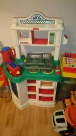 Kids kitchen with accessories and food