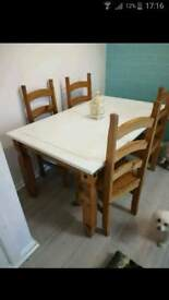 Proper solid wood table and 4 chairs