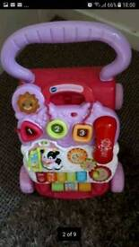 Baby walker in good condition + a free scoop & whirl