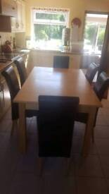 Solid wood extendable dining table and 6 leather high backed chairs