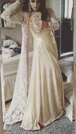 Faika Karim gold dress and gown