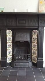 Calder Victorian wrought iron fireplace with grate. Authentic tiles in tact. Excellent condition.