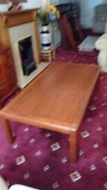 Large solid wood teak coffee table.