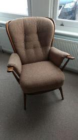 Ercol Evergreen High Back Armchair, solid wood dark beech frame, light brown upholstered cushions