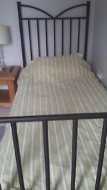 Black metal single bed frame