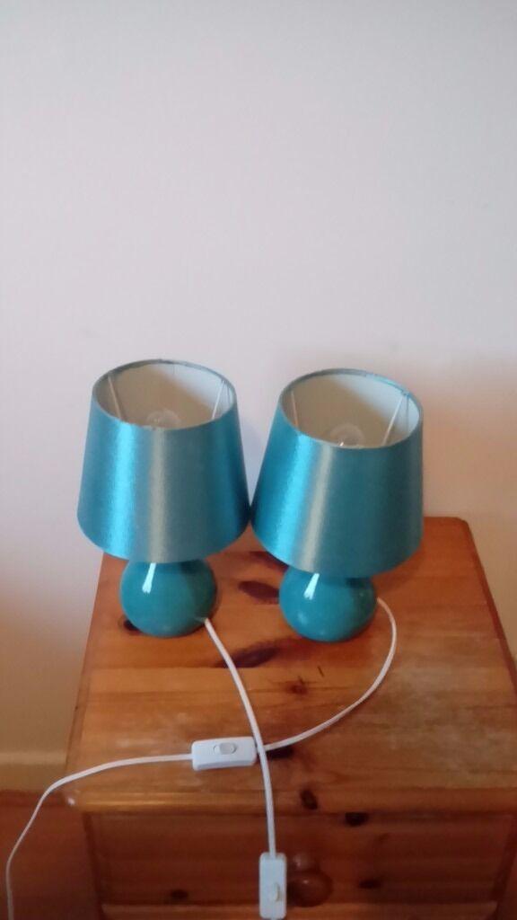 2 Teal coloured bedside lamps
