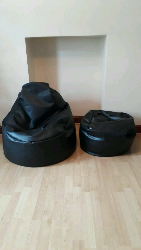 Black bean bag chair with matching foot stool