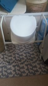Free nearly new commode with 4 inch seat