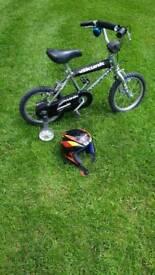 Childs BMX bike and helmet