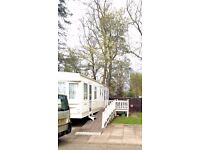 8 BERTH CARAVAN AT HAGGERSTON CASTLE OCTOBER HALF TERM.