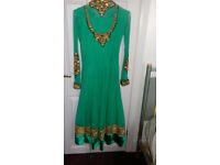 Green party dress with black and gold embroidery