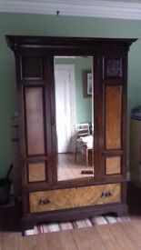 Antique bedroom furniture; matching set includes wardrobe, dresser and bed.