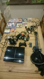 PlayStation 3 80gb plus games and extras