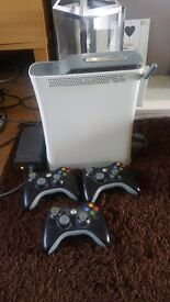 Good condition x box 360 . 3 controllers will give away logitech speakers
