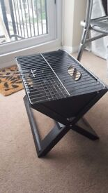 Portable foldable notebook barbecue - good for picnics and camping