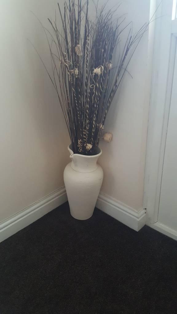 Vase and sticks