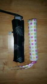 Two folding ladies umbrellas.