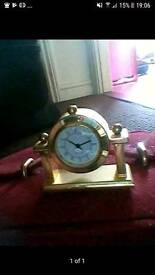 Heavy gold miniature mantlepiece clock