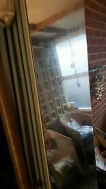 Mirrored wardrobe doors. .