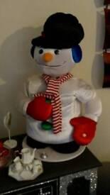 Large snowman plays music
