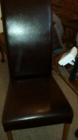 Brown leather dining chairs. Set of 10.