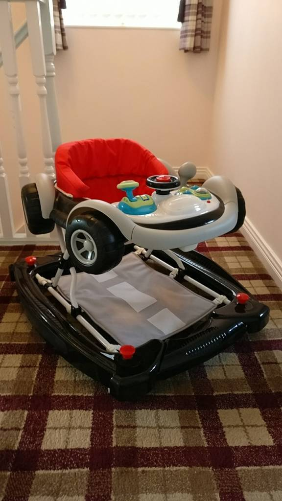Black and red coupe baby walker rocker