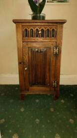 Small solid oak cabinet with acorn handles. Old and very well made.