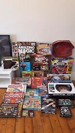 Loads of kids toys and board games half of which still remain unopen