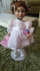 """PARADISE GALLERIES """" A PARTY FOR SARAH """" COLLECTABLE PORCELAIN DOLL ON STAND"""