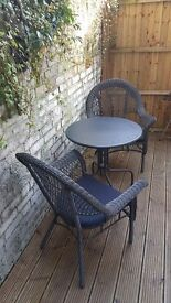 Two rattan chairs and a table - perfect condition