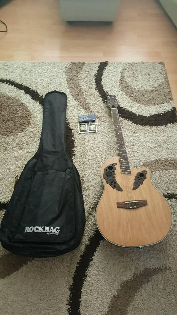 Unused electric acoustic guitar