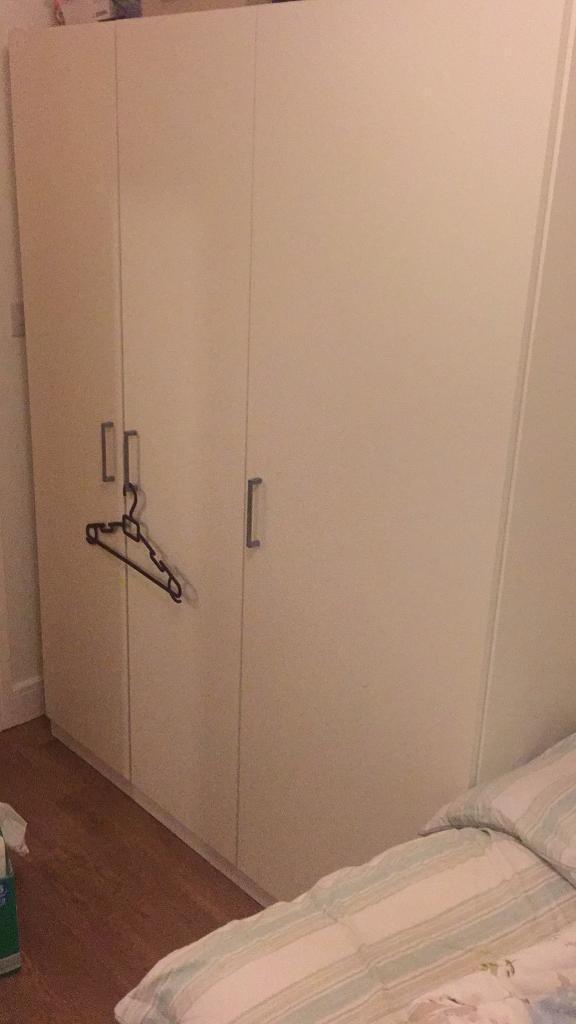 Ikea 3 door cupboard.