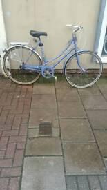 "Blue Raleigh Hybrid Bike, 700c Wheels, 3 Speed, 22"" Frame"