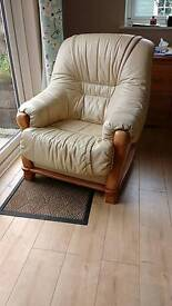 2 cream leather arm chairs