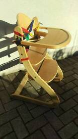 Child's wooden high chair and tray with secure harness
