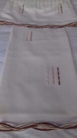 Immaculate pair of cream voile pencil pleat curtains with matching pelmet