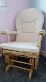 Nursing/rocking chair with gliding footstool