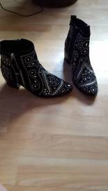 Black and silver boots