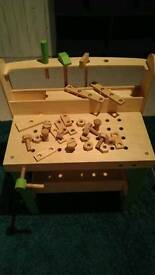 Plum wooden child's workbench