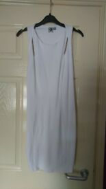 Ladies white dress figure hugging so comfortable to wear