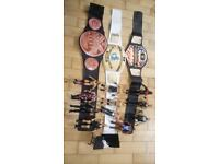 Wrestling figures, belts and table £25