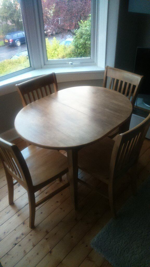 Extending dining table with matching four chairs £40.00