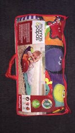 Tummy time activity toy and rug