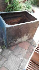 Old metal riveted water tank