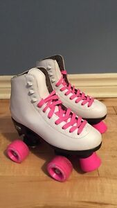 Girls White roller skates with pink laces and wheels
