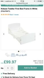 White toddler bed frame with mattress, in great condition.