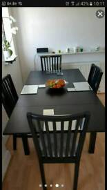 Extendable dinning table and 4 chairs