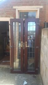 French doors with frame and window included on top
